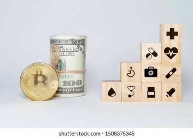 Concept of insurance for your health on wooden block with healthcare medical icon, fake money and Bitcoin.