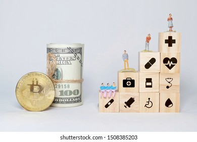 Concept of insurance for your health on wooden block with healthcare medical icon, miniature, fake money and Bitcoin.