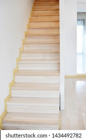Concept of an interior modern beige stairway. Vertical. Front view, copy text.