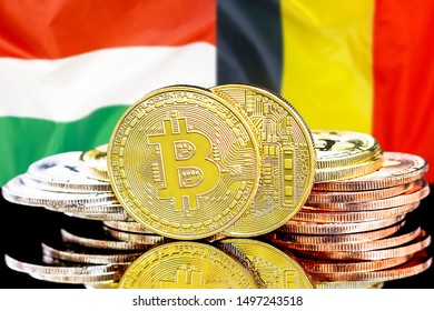 Concept for investors in cryptocurrency and Blockchain technology in the Belgium and Hungary. Bitcoins on the background of the flag Belgium and Hungary.
