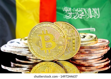 Concept for investors in cryptocurrency and Blockchain technology in the Belgium and Saudi Arabia. Bitcoins on the background of the flag Belgium and Saudi Arabia.