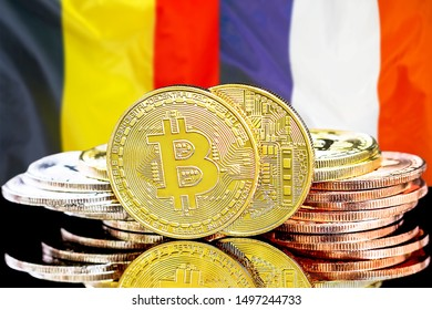 Concept for investors in cryptocurrency and Blockchain technology in the Belgium and France. Bitcoins on the background of the flag Belgium and France.
