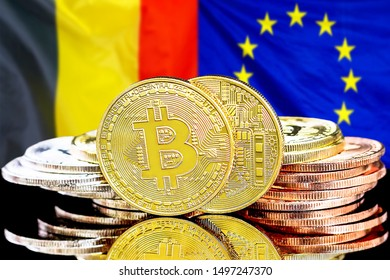 Concept for investors in cryptocurrency and Blockchain technology in the Belgium and European Union. Bitcoins on the background of the flag Belgium and European Union.