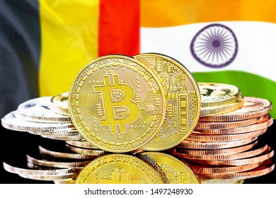 Concept for investors in cryptocurrency and Blockchain technology in the Belgium and India. Bitcoins on the background of the flag Belgium and India.