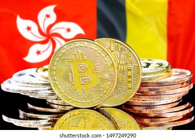 Concept for investors in cryptocurrency and Blockchain technology in the Belgium and Hong Kong. Bitcoins on the background of the flag Belgium and Hong Kong.