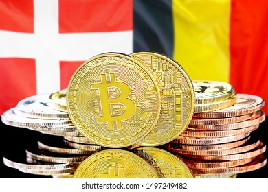 Concept for investors in cryptocurrency and Blockchain technology in the Belgium and Denmark. Bitcoins on the background of the flag Belgium and Denmark.