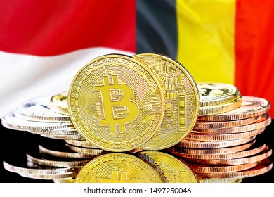 Concept for investors in cryptocurrency and Blockchain technology in the Belgium and Monaco. Bitcoins on the background of the flag Belgium and Monaco.