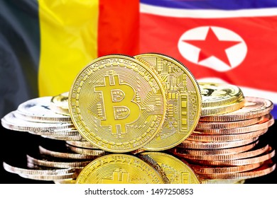Concept for investors in cryptocurrency and Blockchain technology in the Belgium and North Korea. Bitcoins on the background of the flag Belgium and North Korea.