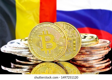 Concept for investors in cryptocurrency and Blockchain technology in the Belgium and Russia. Bitcoins on the background of the flag Belgium and Russia.