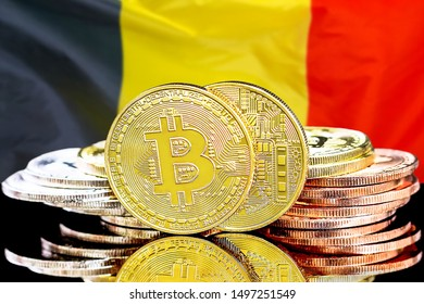 Concept for investors in cryptocurrency and Blockchain technology in the Belgium. Bitcoins on the background of the flag Belgium.