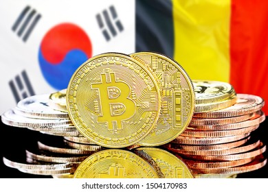 Concept for investors in cryptocurrency and Blockchain technology in the South Korea and Belgium. Bitcoins on the background of the flag South Korea and Belgium.