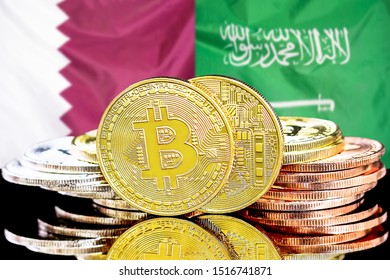 Concept for investors in cryptocurrency and Blockchain technology in the Qatar and Saudi Arabia. Bitcoins on the background of the flag Qatar and Saudi Arabia.