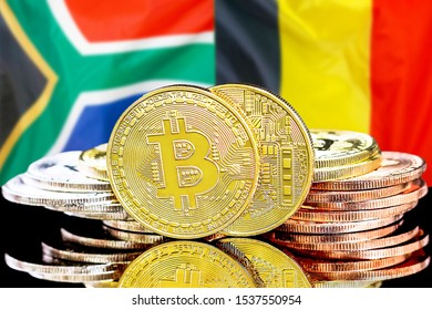 Concept for investors in cryptocurrency and Blockchain technology in the South Africa and Belgium. Bitcoins on the background of the flag South Africa and Belgium.