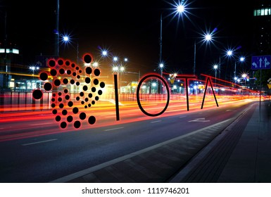 Concept of IOTA coin moving fast  on the road, a Cryptocurrency blockchain platform , Digital money