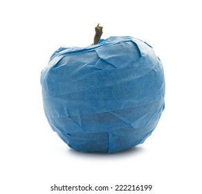 concept isolated object apple fruit wrapped with blue stick tape