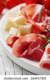 Concept of italian food with cheese, ham, sausage, selective focus