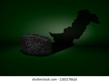 Concept of a karakul cap showing pakistan map in shadow for happy quaid e azam day on green background.