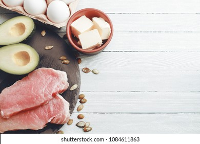 Concept of ketogenic diet. Dietary food on light table