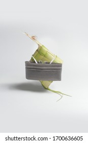 the concept of ketupat in different ramadan, using a mask