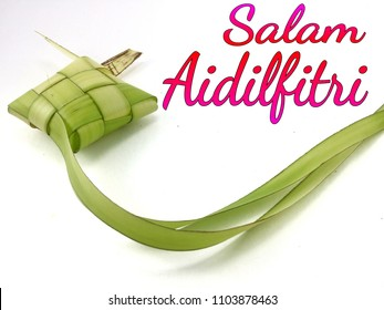 Concept of Ketupat (rise dumpling) with word SALAM AIDILFITRI.(translation: Greeting of Fasting Day Celebration ). Ketupat is most popular dish on muslim hari raya festival.