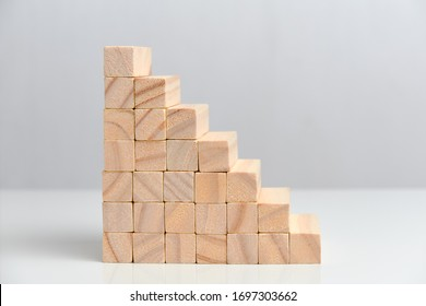 The concept of a large business corporation. Wooden blocks on a white background background. Close up.