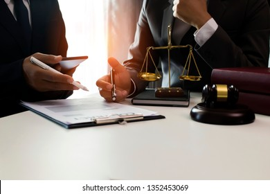 Concept of lawyer. Male lawyer or judge consult having team meeting with client.