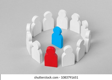 Concept leader of a business team. Crowd of white men stands in circle and listens to leader of blue and red man, work with objections, conflict