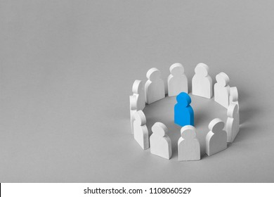 Concept leader of  business team. Crowd of white men stands in  circle and listens to the leader of the blue color