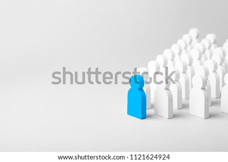 Concept leader of the business team indicates the direction of the movement towards the goal. Crowd of white men goes for the leader of the blue color. Copy space for text