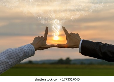 The concept of legality and justice. The hands of lawyers show a paragraph against the background of a sunny sunset.