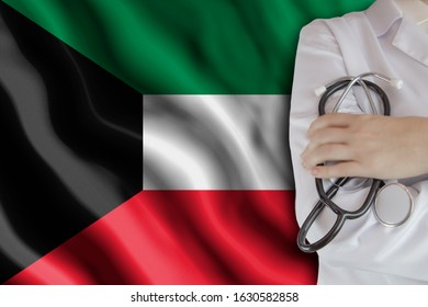 The concept of the level of medicine in the country, the salary of a doctor, the incidence rate in the country. Doctor holds a stethoscope on the background of the flag of Kuwait