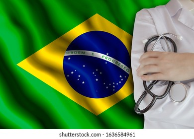 The concept of the level of medicine in the country, the salary of a doctor, the incidence rate in the country. Doctor holds a stethoscope on the background of the flag of Brazil