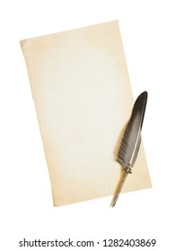 Concept of literary creativity: empty yellowed sheet of old paper and beautiful silver antique feather