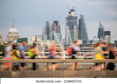 Concept, London cityscape with pedestrian in motion at the foreground