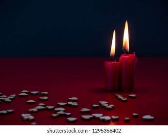 Concept of love Still life with red lit candles and small wood hearts