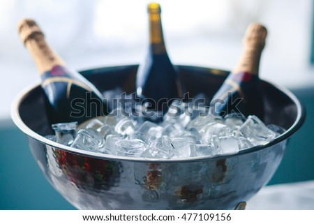 A concept of luxury life with champagne bottle in ice bucket