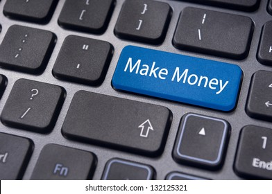 a concept of making money online, with message on enter key of keyboard.