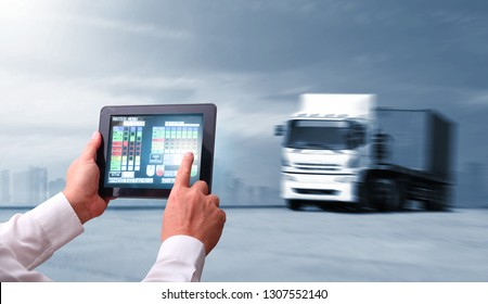 concept  of Man hand holding tablet or cell phone  with Augmented reality screen software and blue tone of automate wireless control Truck run on road, Drive on road, transportation logistic concept
