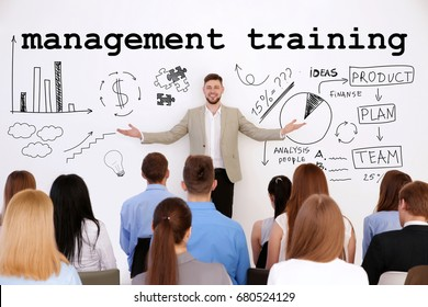 Concept of management training programs. Business trainer with team of managers at conference in office