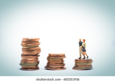 Concept of marriage money planning. Senior Couple walking over coin stack step.