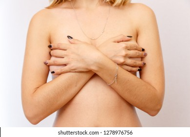 Concept for medicine and cosmetology. A 22-year-old girl after a sharp weight loss shows in detail her body parts with stretch marks and cellulite and asymmetrical breasts. and unshaven pubic hair.