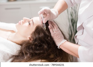 The concept of mesotherapy. Thrust to strengthen the hair and their growth