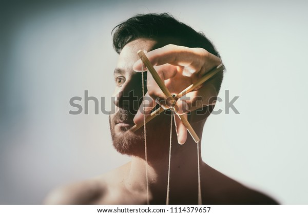 Concept of mind control. Image created using multiple exposures on light background.