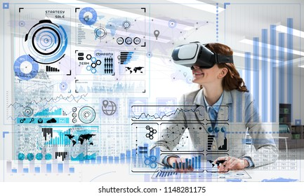 Concept of modern technologies for up to date business needs. Successful business woman in suit using virtual reality goggles and digital media interface.