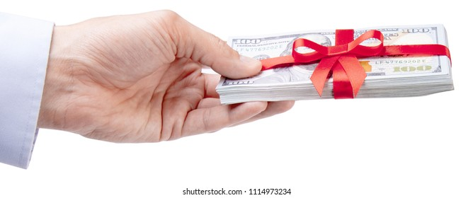Concept, money as a gift, win or bonus. Man's hand in shirt takes or gives pile of 100 dollar bills tied with red ribbon with bow. Isolated on white background.
