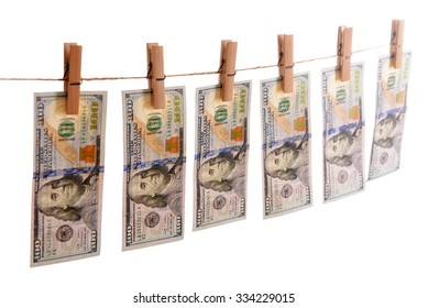 Concept of money laundering - dollars are drying on cord isolated on white background