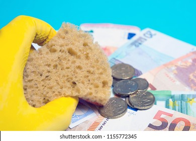 Concept money laundering, euro banknotes and a gloved hand
