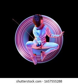 Concept of motion and action in sport. Young caucasian girl fencing in neon light on black background. Training in jump, flight. Sport, healthy lifestyle, movement, advertising. Abstract design.