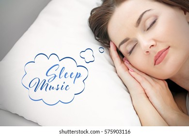 Concept of music for sleep and meditation. Young woman sleeping in bed at home