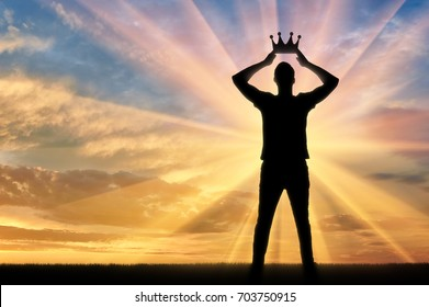 Concept of narcissism and selfishness. Silhouette of a selfish and narcissistic man reconciling his own crown